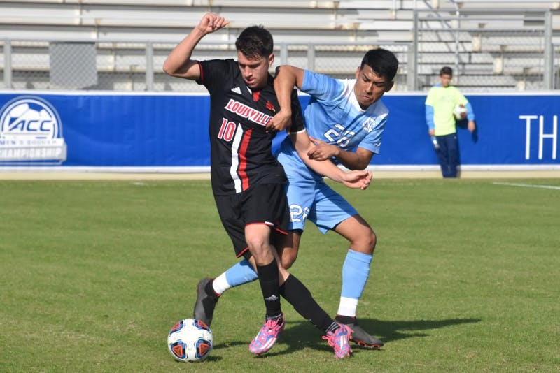 UNC sophomore Raul Aguilera pulls back Louisville senior Tate Schmitt (10) in the ACC championship game on Sunday, Nov. 11, 2018 at WakeMed Soccer Park. UNC lost to Louisville 0-1.