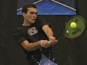 UNC first-year William Blumberg returns a volley during his singles match on Saturday against Bucknell.