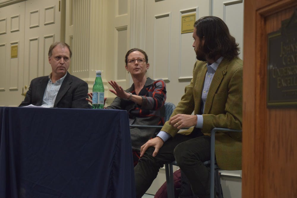 (From left to right) Wayne Lee, professor of History; Hilary Lithgow, professor of English; and Albie Nasland, from the Travis Manion Foundation, participate in the panel on Moral Obligations to Returning Veterans on Thursday, Nov. 15, 2018 in Graham Memorial Hall. This event was hosted by the Carolina Forum for Ethics.