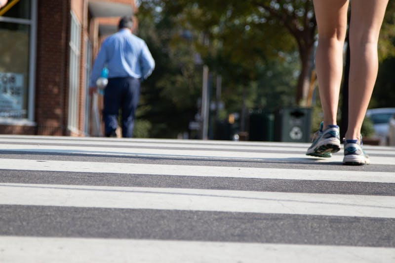 A student walks across a soon-to-be repainted crosswalk on Franklin Street on September 29th.