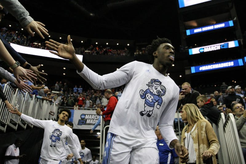 First-year guard Nassir Little (5) high-fives fans as he runs to the court before the game against Washington in the second round of the NCAA tournament at Nationwide Arena in Columbus, OH on Sunday, March 24, 2019. UNC defeated Washington 81-59. Little scored 20 points for the Tar Heels.