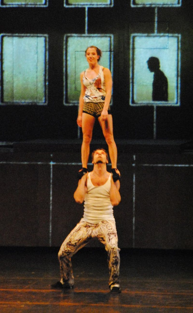 Two acrobats prepare to execute a shoulder-lift during their Cirque Éloize performance at Memorial Hall. The company includes more than 100 artists.