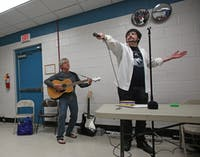 (CROP OUT THE TWO PEOPLE ON THE LEFT) Steve Schlosser (left), 58, and Alex Feltch, 25, who comprise the band Sonic Impact, perform at Push Play Sing, an event that provides musical engagement for people in the community with developmental disabilities. The event took place at the Chapel Hill Community Center on Friday, April 14.