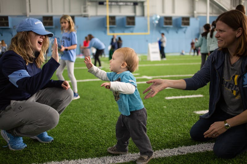 On Sunday, over 1200 people came to UNC's indoor practice facility to participate in National Girls and Women in Sports Day, with all 15 women's varsity teams hosting mini-clinics to allow participants from pre-k through 8th grade to try out new sports.