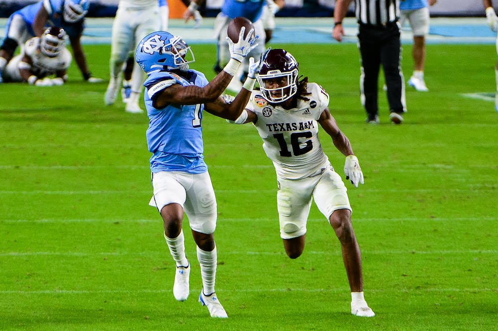 UNC's redshirt first year wide receiver Khafre Brown (1) attempts a catch during the Capital One Orange Bowl against Texas A&M in Hard Rock Stadium on Saturday, Jan. 2, 2021. Texas A&M beat UNC 41-27.