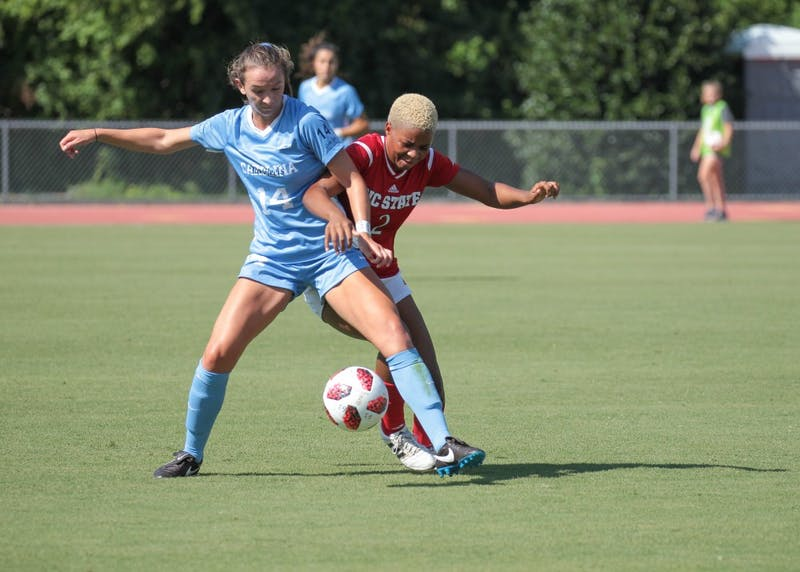 Junior midfielder Morgan Goff fights for possession of the ball in UNC's 3-2 exhibition win over N.C. State on Aug. 9 in Raleigh.