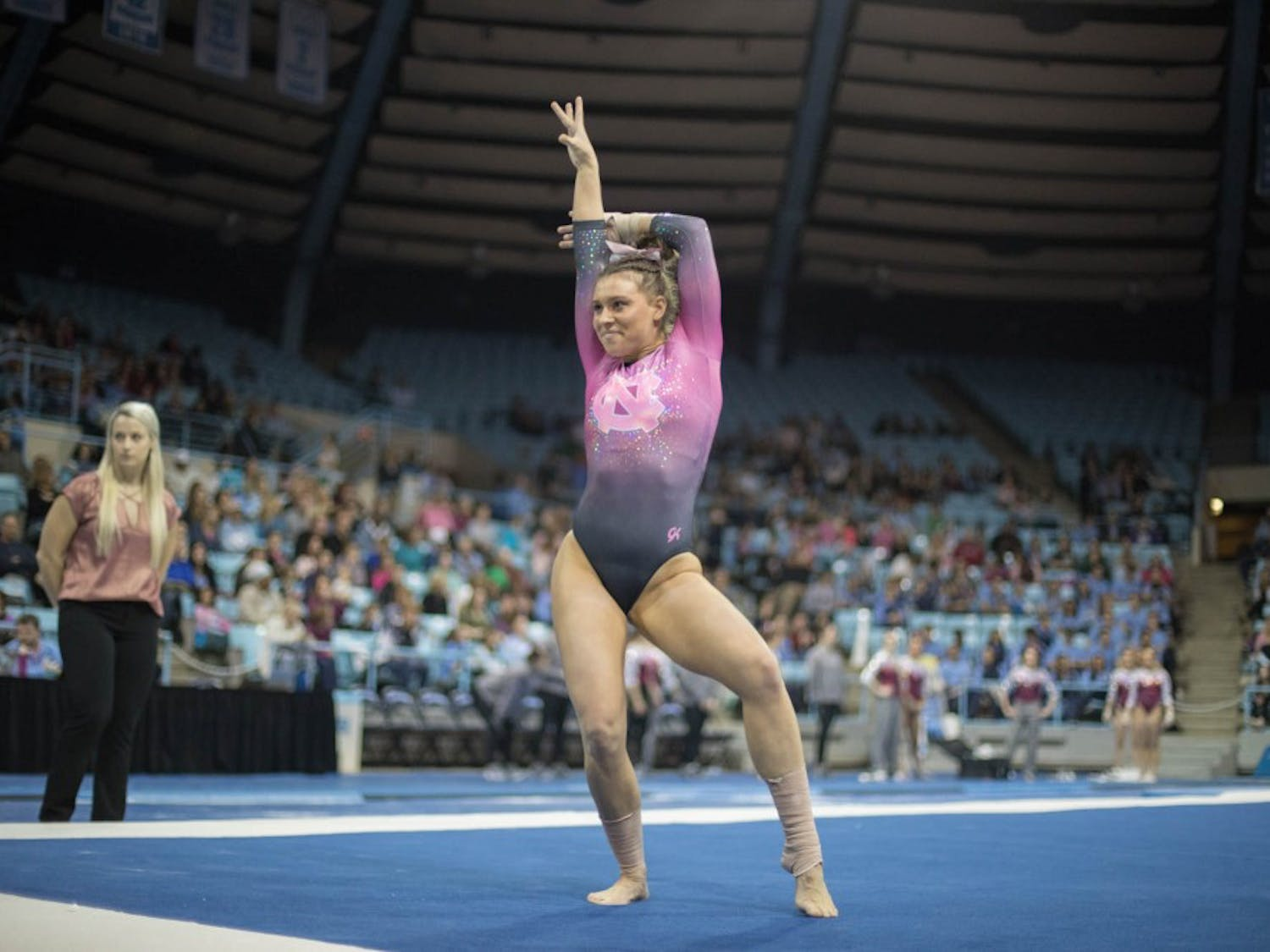 Megan Ruzicka performs her floor routine during home opener and annual Women's Day and Pink Meet against Oklahoma and Ball State on Saturday, Jan. 19, 2019. UNC placed second behind Oklahoma.