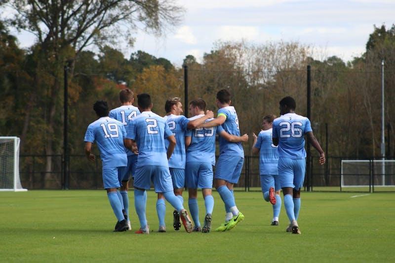 UNC Men's Soccer Team celebrates scoring their first goal against Virginia Tech at Finley Fields on November 4th.