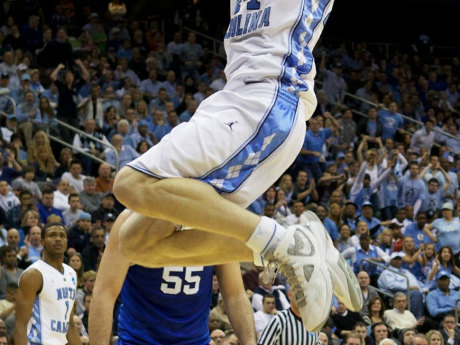 Tyler Zeller dunks in UNC's 2011 NCAA tournament matchup with Kentucky. Zeller, who led the team in scoring, had 21 points in the Tar Heels' 76-69 Elite Eight loss.