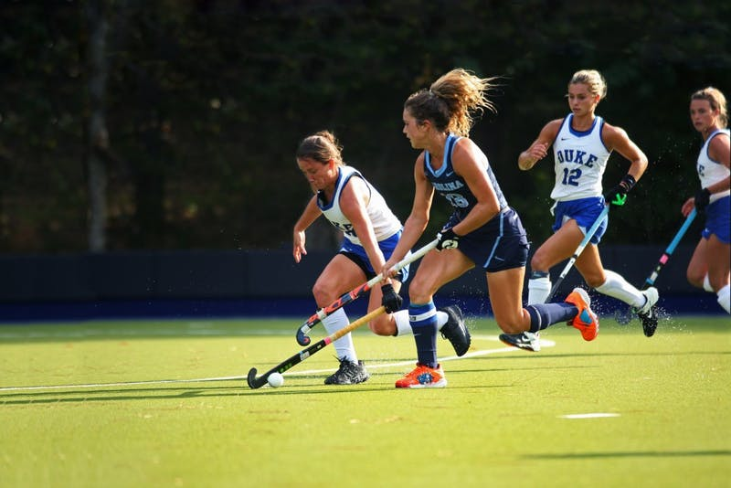 Yentl Leemans (18) races Duke player Haley Schleicher (10) for ball in a field hockey game at Karen Shelton Stadium on Friday Oct. 4, 2019. UNC won 2-0, marking their 33rd consecutive victory.