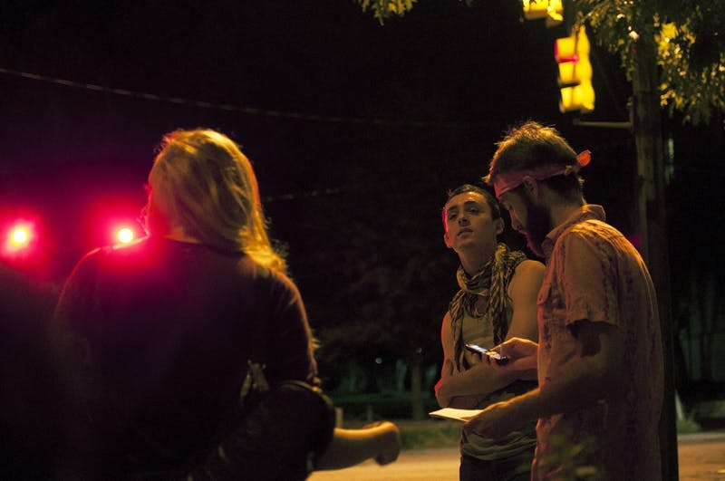 Four students gathered outside of Deep End to stage a silent protest against Country Night's admission policy for underage males. Ana Dougherty, Trevor Dougherty, Nikola Yager. i