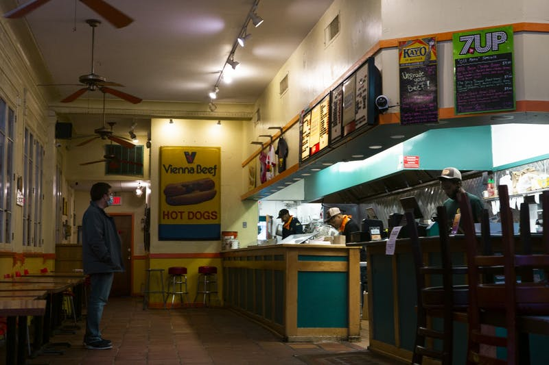 A customer with a mask on at Edzo's Burger Shop in Evanston, IL on Friday, May 8, 2020 waits in line for his order, while the employees have no form PPE. In North Carolina upon entering Phase 2 of COVID-19 recovery, it will be required for all employees and strongly recommended for customers of restaurants and local businesses to wear masks to prevent against the spread of the virus.