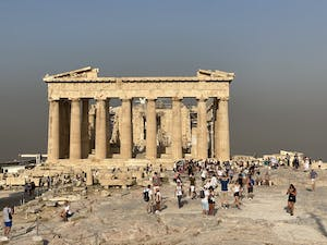 A cloud of smoke from nearby wildfires surrounds the Parthenon in Athens, Greece on Aug. 4.