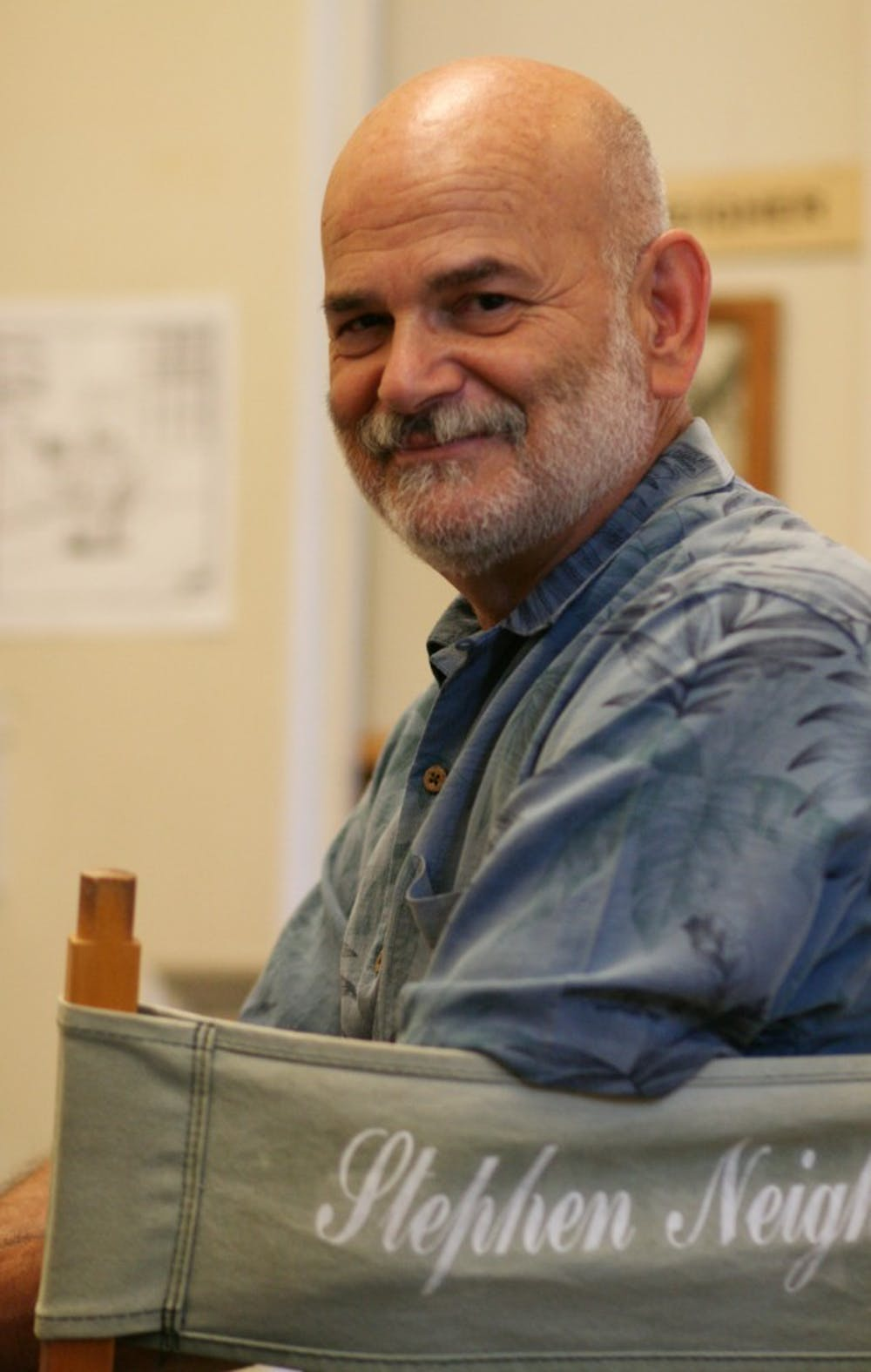 Professor Stephen Neigher has taught screenwriting classes for the past seven years at UNC.  Above, he sits in is his director's chair, one of many mementos he keeps in his office at UNC to remember his time working in Hollywod in the TV and film industries.