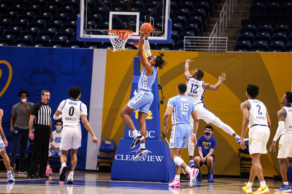 UNC sophomore center Armando Bacot (5) attempts a dunk during a game against Pitt on Tuesday, Jan. 26, 2021. UNC beat Pitt 75-65. Photo courtesy of Alex Mowrey.