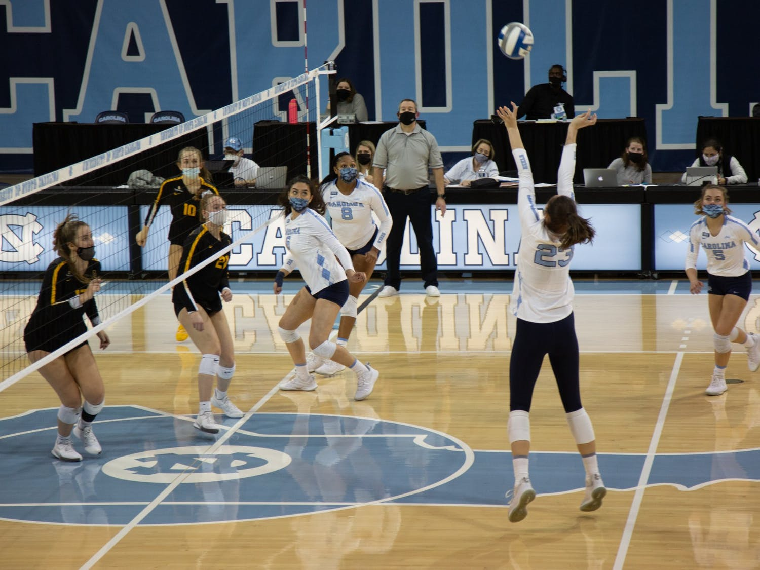 Sophomore outside hitter Parker Austin (23) prepares to hit the ball in a volleyball game against Appalachian State University on Thursday, Feb. 18, 2021 in Carmichael Arena. The Tar Heels won 3-0.