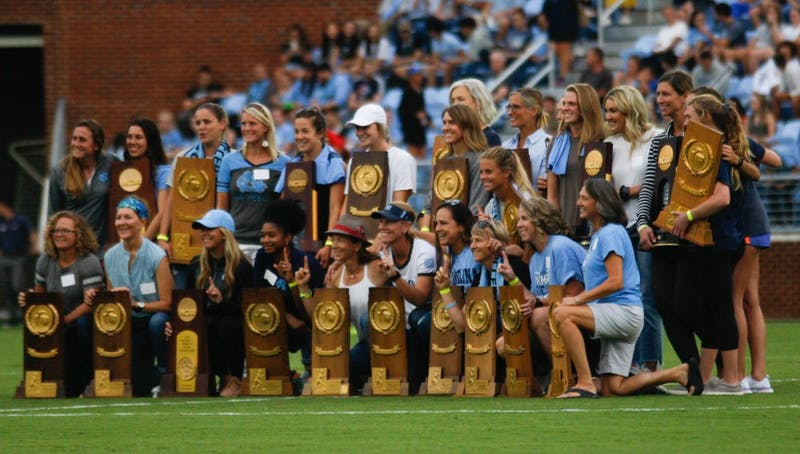 UNC women's soccer alumna pose for a picture after being recognized during halftime at the game against Duke on August 25, 2019. UNC beat Duke 2-0.