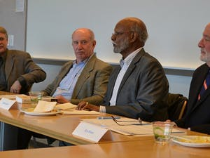 Panelists - from left to right - Michael Lambert, Ken Brown, Bereket Selassie, and Ron Strauss, talk at the First Installment of the Nelson Mandela Lunch Panel Discussion on Monday afternoon in the Fed Ex Global Center.
