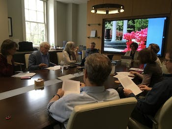 Members of the Faculty Executive Committee discuss at Monday's meeting.