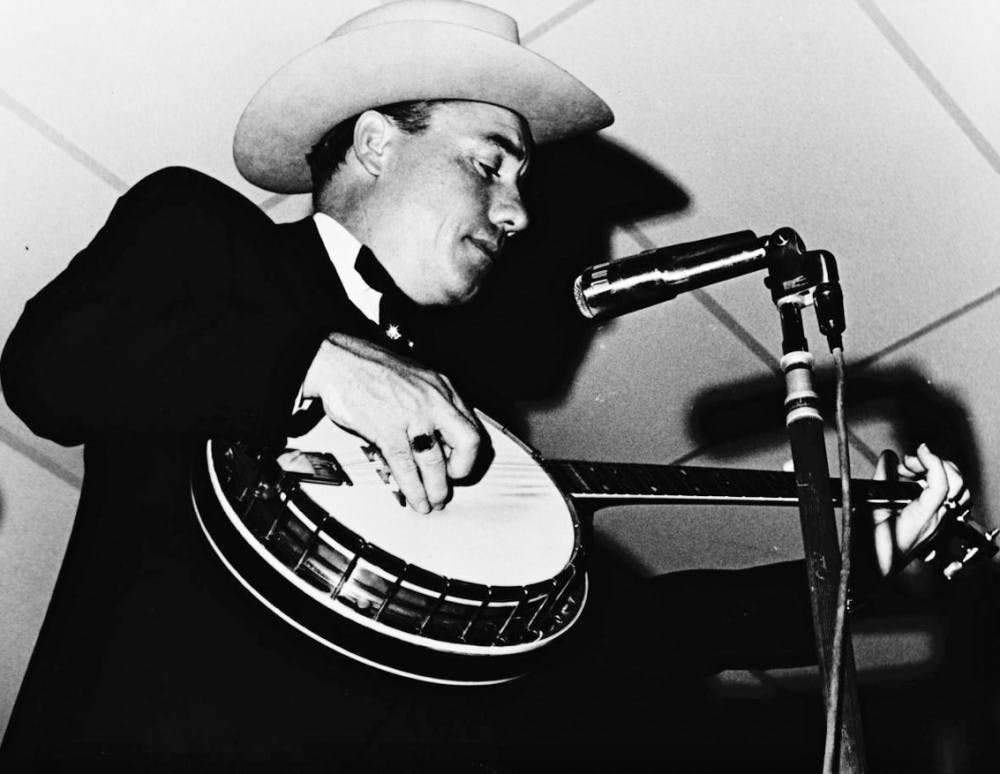 <p>North Carolina native Earl Scruggs is seen playing banjo in Miami in 1969. Scruggs popularized a three-finger banjo-picking style.</p>