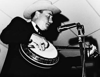 North Carolina native Earl Scruggs is seen playing banjo in Miami in 1969. Scruggs popularized a three-finger banjo-picking style.
