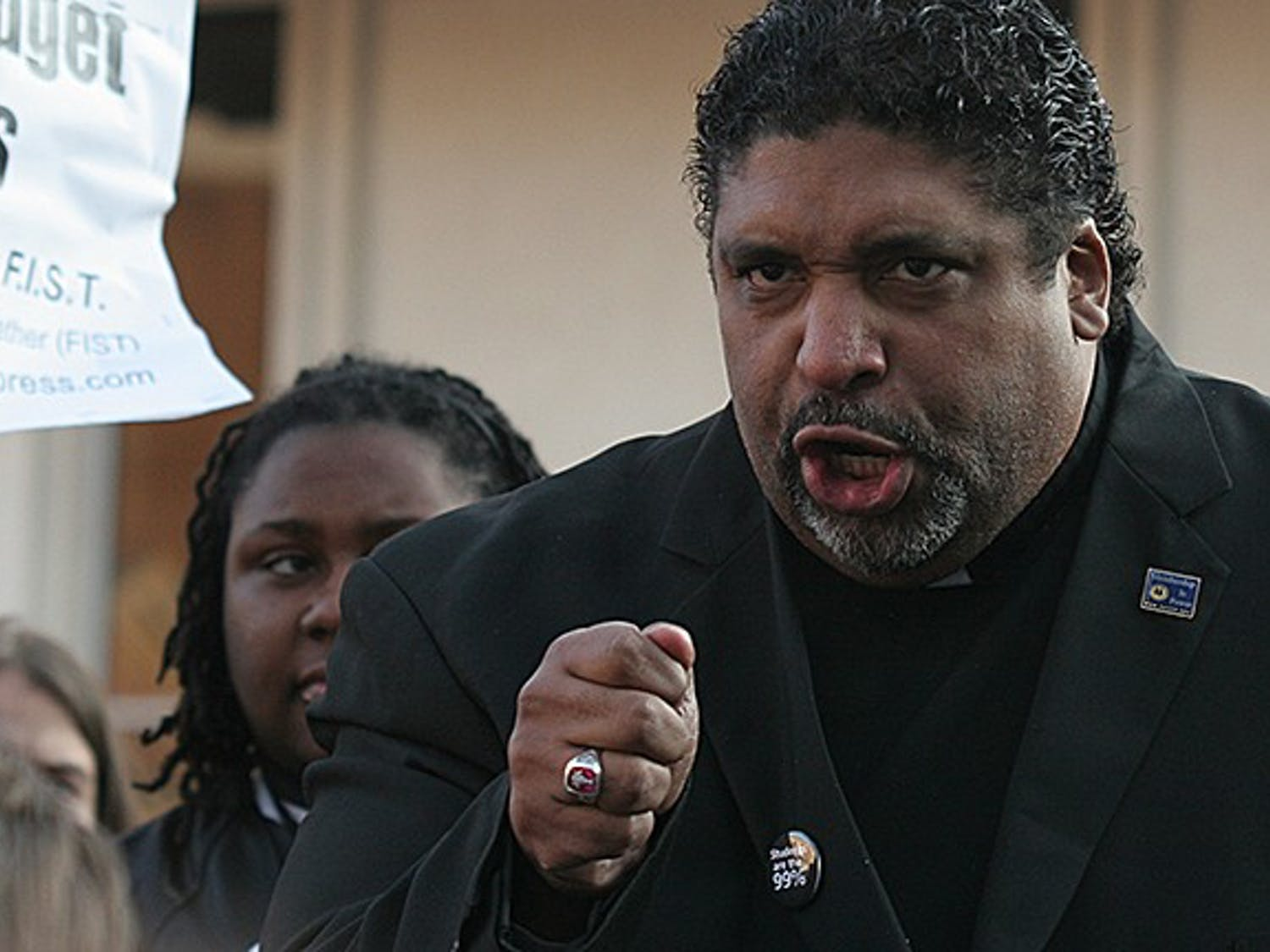 """Rev. Dr. William J. Barber II, president of the North Carolina chapter of the NAACP, speaks to students of the BOG protest Friday morning.""""You are the student movement of this generation.""""""""Forward together, not one step back!""""""""We will not be divided, nor defeated.  We are the generation that refuses to go backwards."""""""