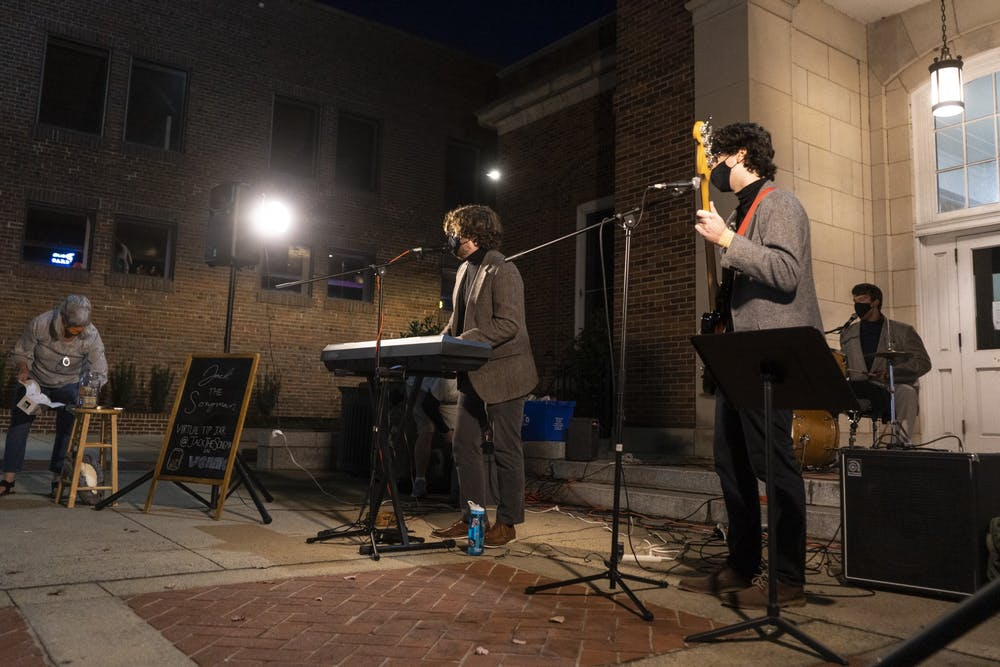 "Local band ""Jack the Songman"" plays outside of the Chapel Hill Courthouse on Saturday, Nov. 7, 2020. with social distance and mask policies in place for COVID-19 safety."
