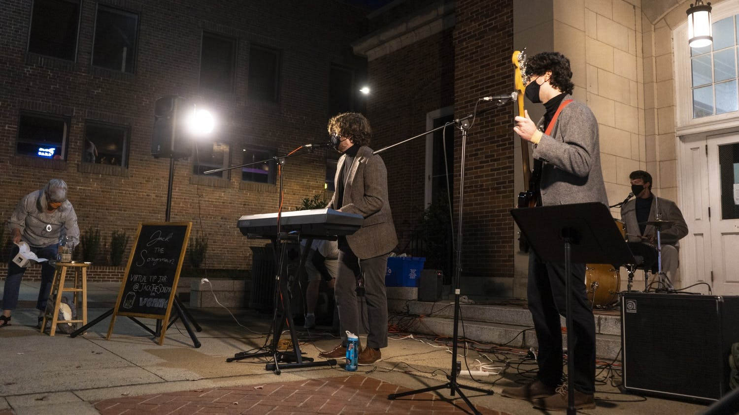 """Local band """"Jack the Songman"""" plays outside of the Chapel Hill Courthouse on Saturday, Nov. 7, 2020. with social distance and mask policies in place for COVID-19 safety."""