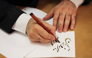 Majid Roohafza was the calligrapher at the event. He has done Persian calligraphy since he was 9 years old.