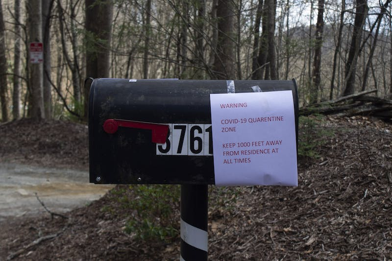 A malibox in Gerton, NC featuring a sign warning passerbys of a COVID-19 quarantine zone on Saturday, March 21, 2020. According to the North Carolina Department of Health and Human Services, there are 398 reported cases of coronavirus in the state.