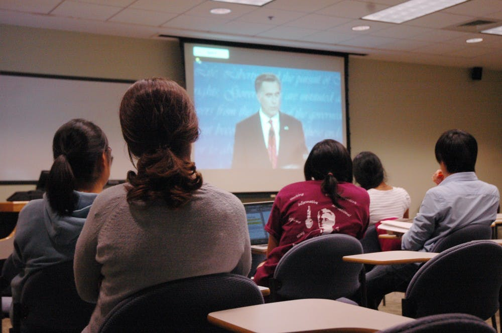 Students gather to watch debate