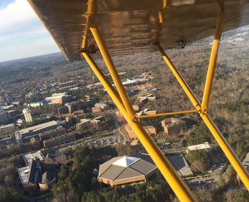A view of the Dean Dome and South Campus is seen from the Piper Cub.