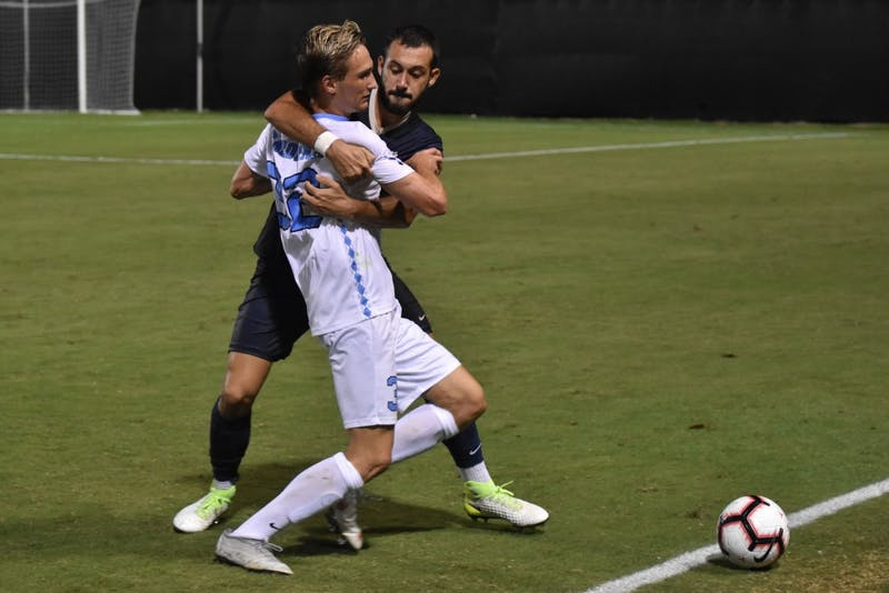 Midfielder Milo Garvanian (32) fights for the ball against defender Jose Luis Sena Arbona (14) during Saturday night's game against Pittsburgh at Koskinen Stadium.
