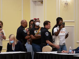 Demonstrators gather at the Board of Trustees' special meeting on June 30 as the Board goes into closed session to deliberate on Nikole Hannah-Jones' tenure case.