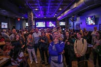 Crowds look on to voting updates at Might as Well, where the Orange County Democratic Party held an election party Tuesday.