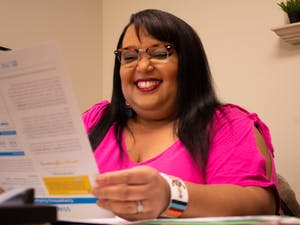 """""""Dream big and plan big,"""" says April Parker in her third floor office of the School of Social Work. Professor Parker recently won the Larkins Award for her work with diversity and inclusion within the field of social work and therapy."""