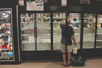 Shoppers at Harris Teeter have a hard time getting what they need before Hurricane Florence because bread, water, milk and eggs are scarce at stores.