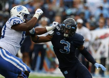 UNC linebacker Dominique Ross (3) attempts to rush past Duke offensive tackle Jacob Monk (63) during the football game on Saturday, Oct. 26th, 2019 at Kenan Memorial Stadium.