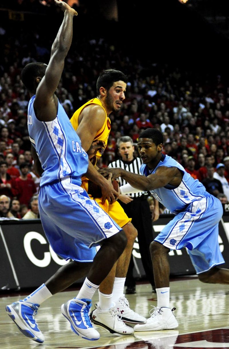 Dexter Strickland attempts to strip the ball from Maryland's Greivis Vasquez. Courtesy of Jaclyn Borowski/The Diamondback