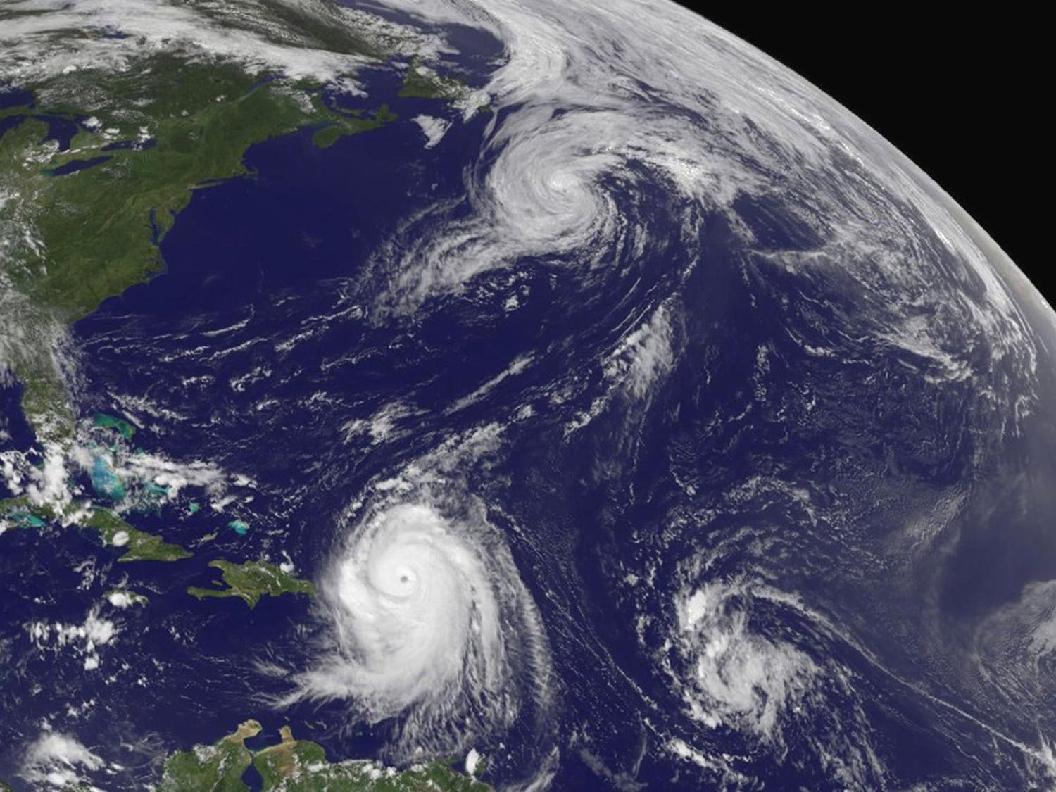 The current Geostationary Operational Environmental Satellite GOES-13 captured this image of Hurricane Danielle heading for the north Atlantic (top center), Hurricane Earl with a visible eye hitting the Leeward Islands (left bottom) and a developing tropical depression 8 (lower right) at 1:45 p.m. EDT on August 30, 2010. (NASA GOES Project/MCT)