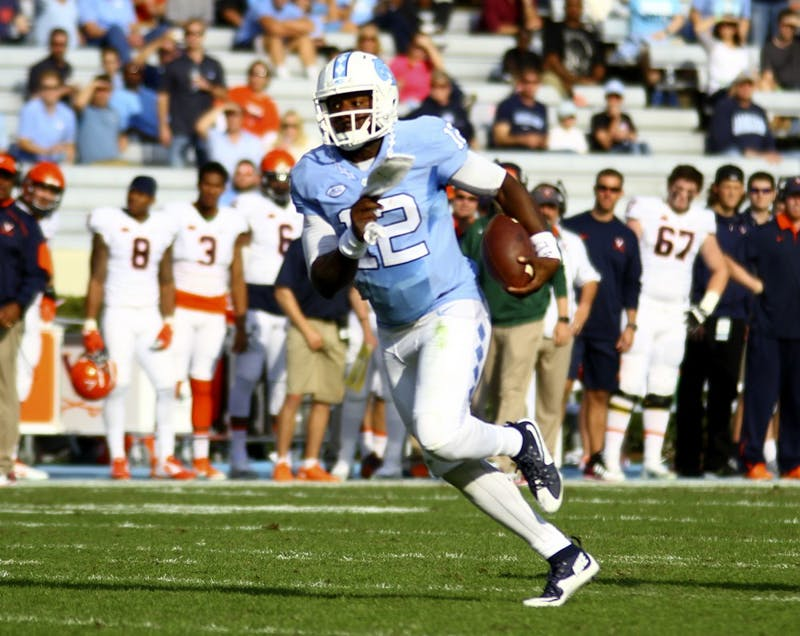 Marquise Williams (12) runs the ball in UNC's win over Virginia on Saturday. Williams netted 71 rushing yards during the game.