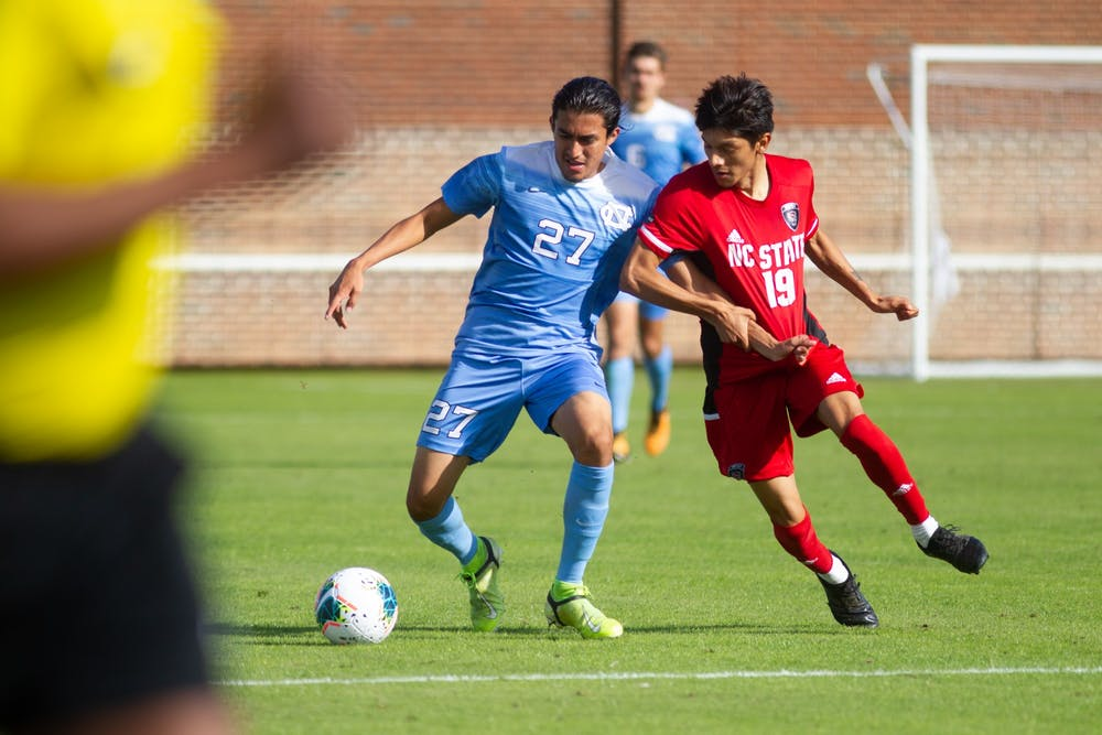 Senior defender Mark Salas (27) fights for a ball during a 0-0 draw against NC State on Sunday, Nov. 1, 2020.