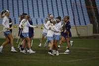 The UNC women's lacrosse team celebrates after a goal against ECU in Kenan Memorial Stadium on Saturday Feb. 17, 2019. UNC won 21-3.