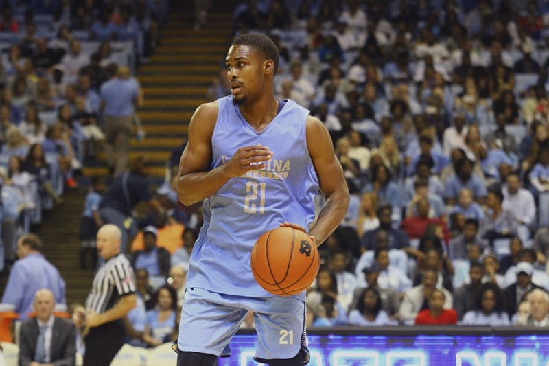 Seventh Woods (21) looks for a teammate to pass the ball to during a scrimmage at Late Night With Roy on Friday night.