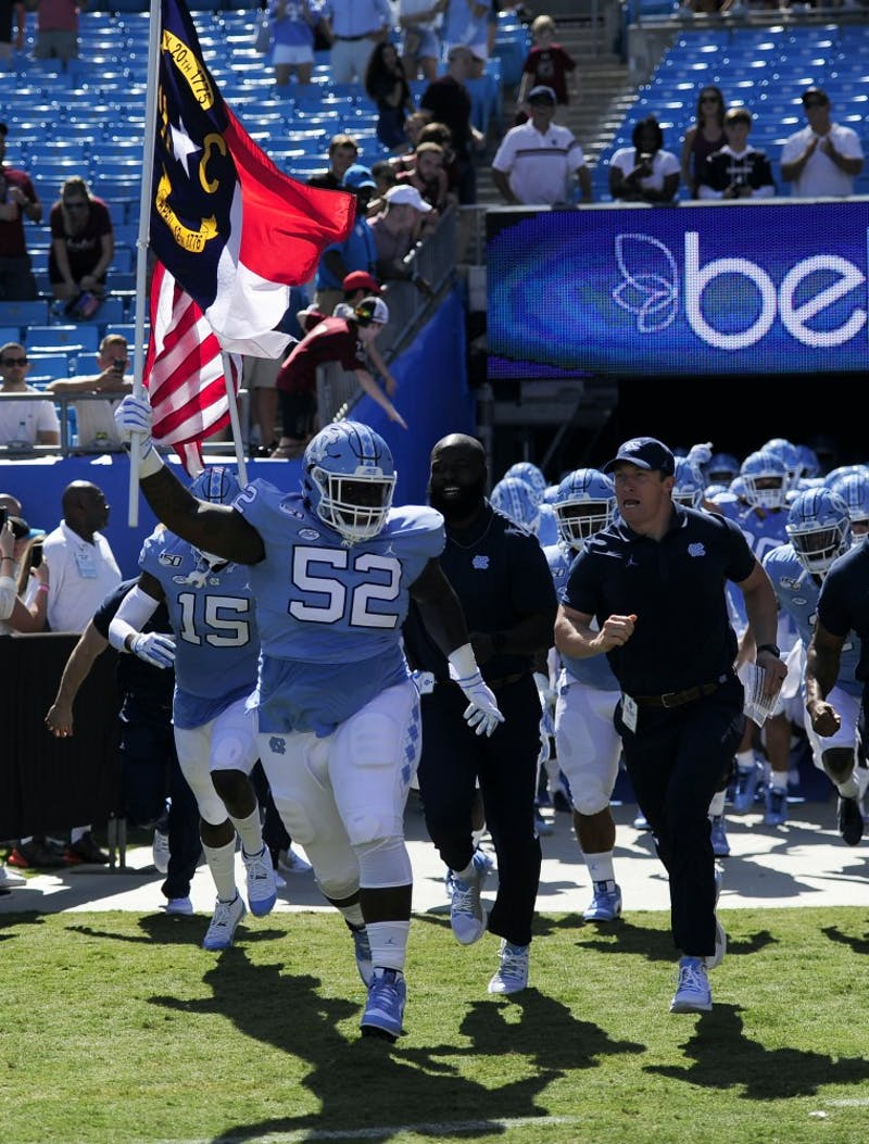 UNC football players run out of the tunnel before the Belk College Kick Off in Charlotte, NC on Saturday, August 31, 2019.