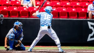 UNC first-year outfielder Will Stewart (12) gets ready to bat at the NCAA tournament game against UCLA on Sunday June 6, 2021 in Lubbock, TX. The Tar Heels lost 2-12. Photo courtesy of Elise Bressler.