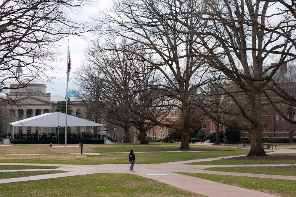 <p>A UNC student walks through the quad on Wednesday, Feb. 10, 2021. &nbsp;Although in-person instruction for selected classes was scheduled to begin on February 8th, some instructors have chosen to delay the start of their in-person instruction or cancel it altogether.</p>