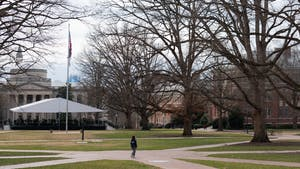 A UNC student walks through the quad on Wednesday, Feb. 10, 2021. Although in-person instruction for selected classes was scheduled to begin on February 8th, some instructors have chosen to delay the start of their in-person instruction or cancel it altogether.