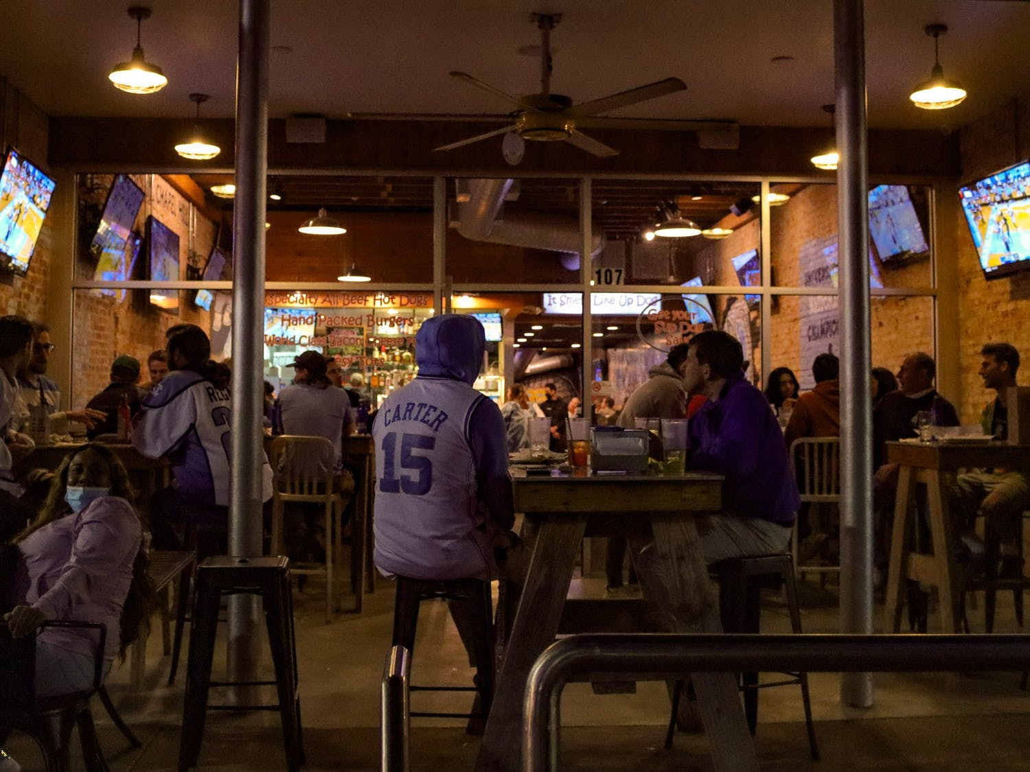 Students gather in Sup Dogs on Franklin Street to watch UNC's 91-73 defeat of Duke basketball on March 6, 2021.