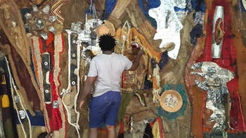 Artist Jean Michel Dissake painting. Photo courtesy of Marriot Sheldon.